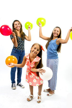 Smiling girls posing with colorful balloons photo