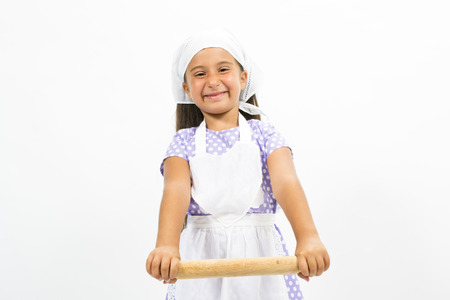 Small smiling chef with kitchen utensils photo