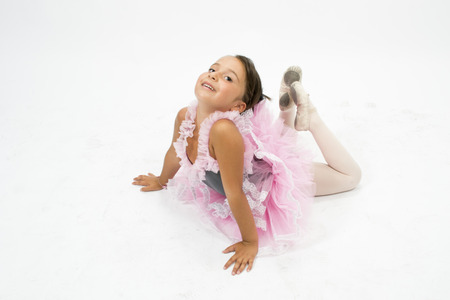 first floor: Beautiful little girl posing in ballet with tutu
