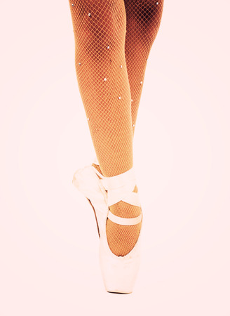 fishnets: Young ballet dancer dancing on pointe