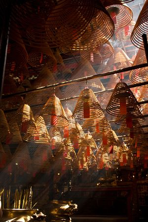 crepuscular: Incense and crepuscular rays in Man mo temple, Hong Kong Stock Photo