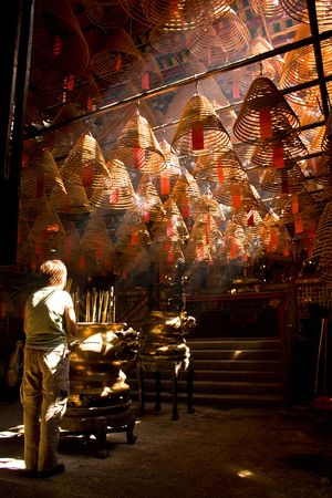 mococa: Incense and crepuscular rays in Man mo temple, Hong Kong Stock Photo