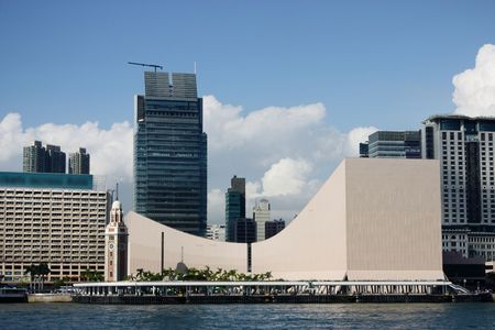 urban culture: Hong Kong Cultural Centre with blue sky and nice cloud.