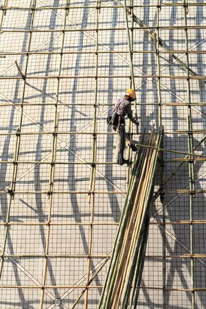 building a scaffold with bamboo in Hong Kong photo