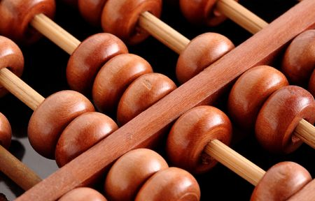 calculator chinese: A closeup of abacus with black background Stock Photo