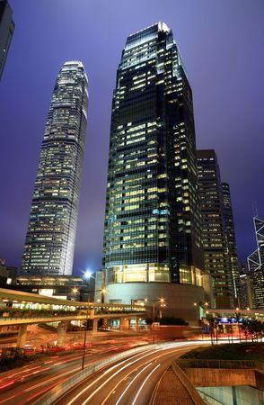 Skyscraper with traffic light and cars motion blurred in Hong Kong Stock Photo - 6104633