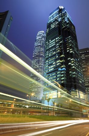 Skyscraper with traffic light and cars motion blurred in Hong Kong Stock Photo - 6104631