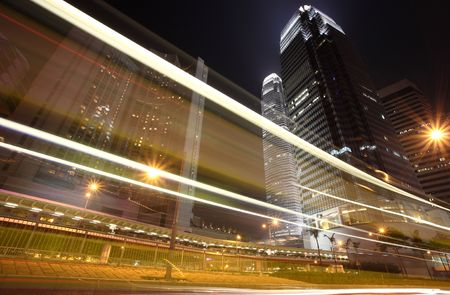 Skyscraper with traffic lighst and cars motion in Hong Kong Stock Photo - 6134490