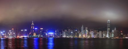 Panorama of the skyline of Hong Kong at night, with mist Stock Photo