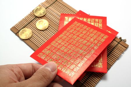 lucky charm: red envelopes and coins for Chinese New Year