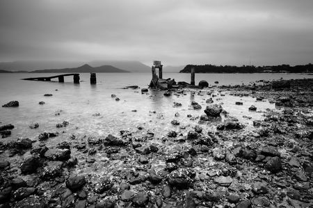 dreary: a desolate and broken peer on the beach