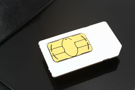 sim card on a black metal background photo