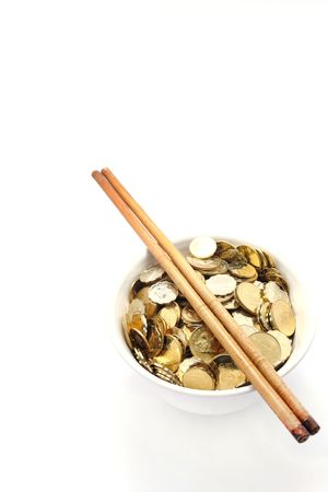 coins shot in golden color: a bowl of money with chopsticks
