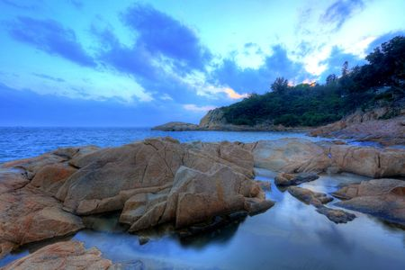 sunset time on coast, in Cheung Chau, Hong Kong photo