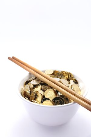 bowl of money with chopsticks  photo