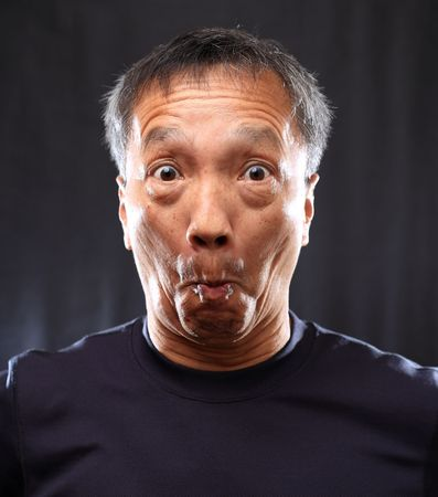 silly: mature chinese man shocked Stock Photo
