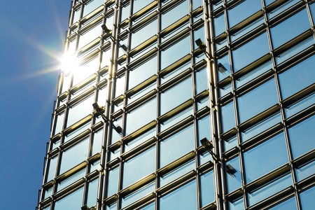 modern business building exterior with sun light photo