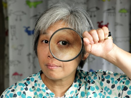 woman holding magnifier photo