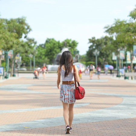 street fashion: fashion girl walking on street with soft color tone