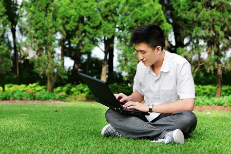 man using computer outdoor Stock Photo - 7628087