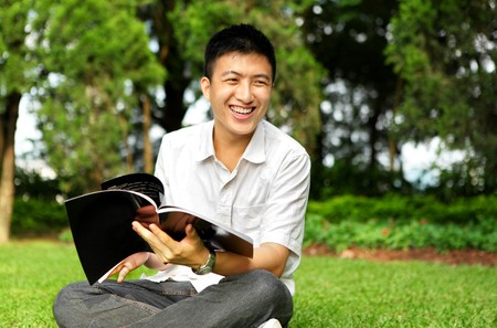 man chat and smile with book outdoor photo