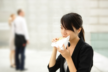 young business woman have sandwich for lunch photo