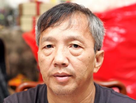 vecchiaia: asian uomo di mezza et�  Archivio Fotografico