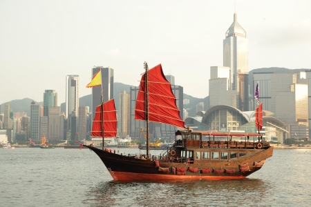 sailboat sailing in the Hong Kong harbor photo
