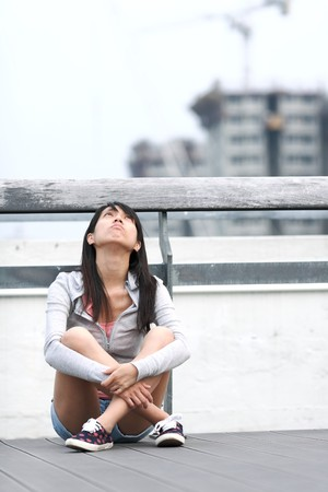 sad lonely girl: depressed girl looking to the sky Stock Photo