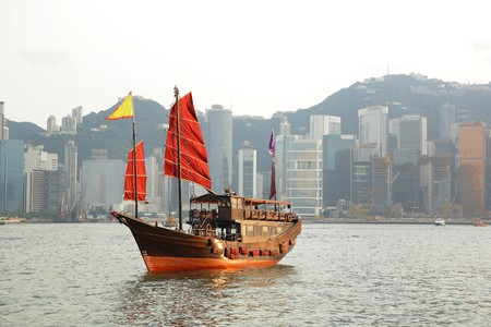 Hong Kong harbour with tourist junk Stock Photo - 8215575