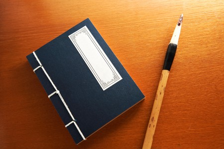 antique asian: chinese book and writing brush Stock Photo