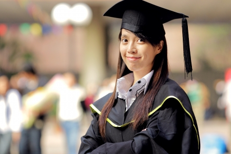 cap and gown: asian girl graduation Stock Photo