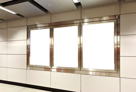Blank billboard in metro station photo