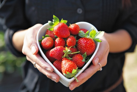 healthy growth: strawberries in heart shape bowl
