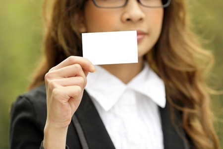 woman showing blank card photo