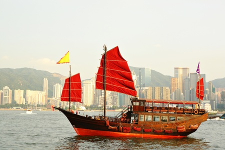 Hong Kong harbor with red sail boat Stock Photo - 8836796