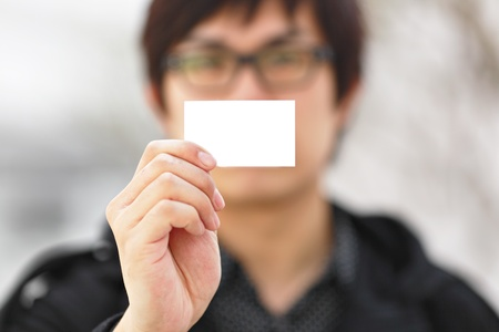 showing blank business card photo