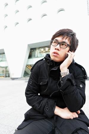 man talking on mobile phone photo