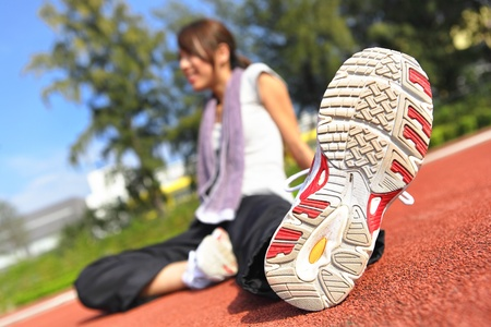 woman doing stretching exercise in sport field Stock Photo - 9040665