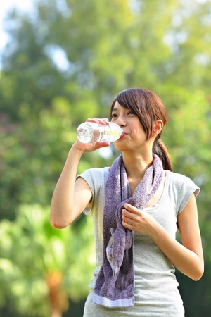 woman drink water after sport Stock Photo - 9113780