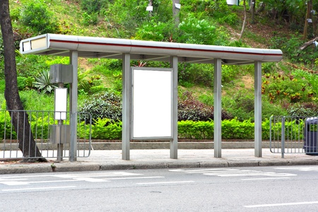 public space: Blank billboard on bus stop Stock Photo