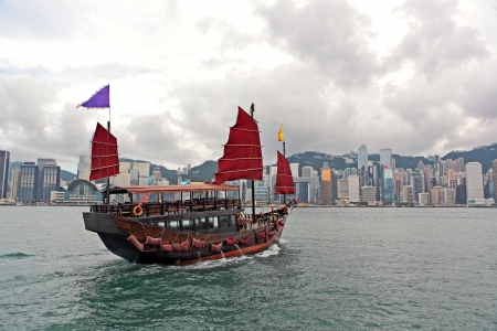 ferry: Hong Kong harbour with tourist junk