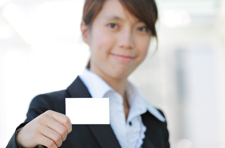 business woman showing blank card photo