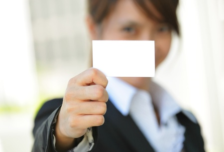 Business woman with business card Stock Photo - 9996369