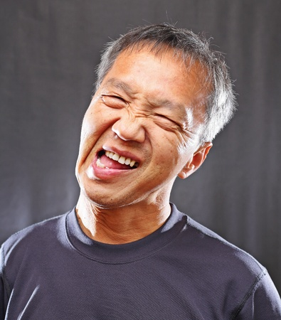 mature chinese man with funny face photo