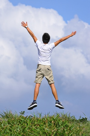 happy man jump freely Stock Photo - 9996291