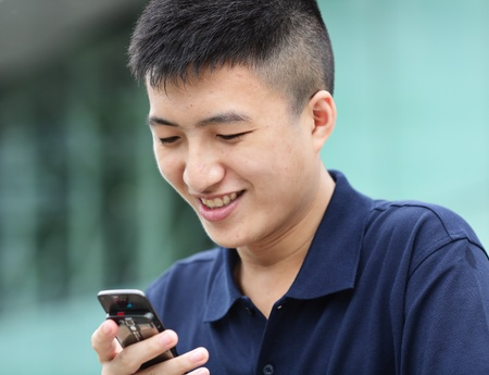 man sms on cell phone Stock Photo - 10089391