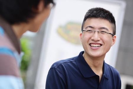 handsome student: amigo en el chat Foto de archivo