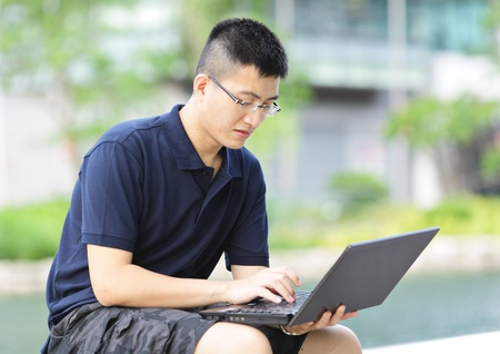 man using computer outdoor photo