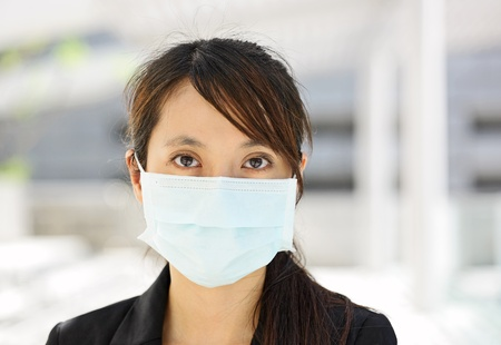 female mask: woman with face mask Stock Photo